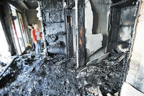 女老板点火烧毁出租屋 称起床后感到心烦(图)